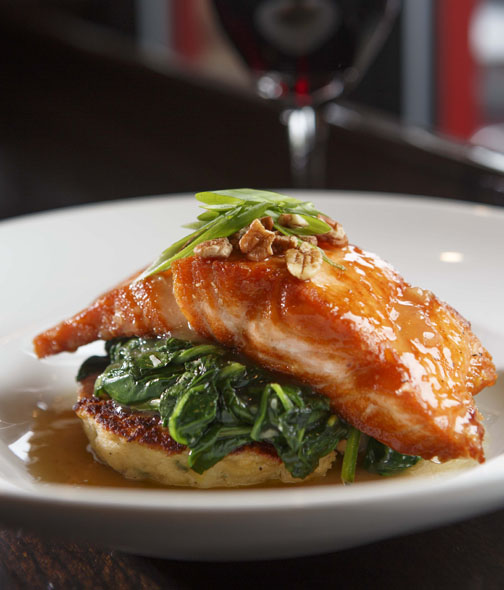 During Triangle Restaurant Week, visit Doherty's Irish Pub in Cary or Apex. On the regular menu is salmon, grilled and brushed with a cider and whiskey glaze. It is served with sautéed spinach, a scallion and cheddar potato cake, and finished with a sprinkling of pecans.
