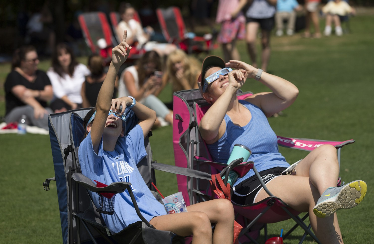 Erin and Kelly Curtis of Cary enjoy the eclipse at North Cary Park.
